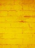 Fondo del extracto del Grunge del ladrillo del oro Foto de archivo libre de regalías