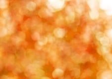 Fondo del extracto del oro del otoño, luz borrosa del sol Fotografía de archivo libre de regalías