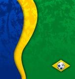 Fondo del fútbol del Grunge en colores de la bandera del Brasil Foto de archivo