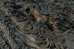 Fondo del giacimento di lava congelato onde al vulcano di Tolbachik, dopo l'eruzione nel 2012, gruppo di Klyuchevskaya di vulcani Immagini Stock Libere da Diritti