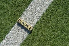 Fondo del gioco e piccoli cubi con testo tematico immagini stock libere da diritti