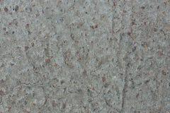 Fondo del hormigón con impregnaciones de la grava roja del granito con una superficie desigual Fotografía de archivo libre de regalías