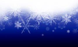 Fondo del invierno con las escamas de la nieve Fotos de archivo libres de regalías