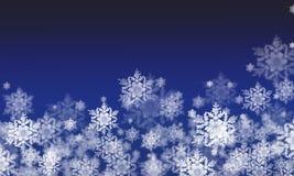 Fondo del invierno con las escamas de la nieve Fotografía de archivo
