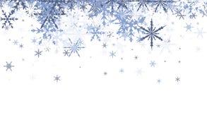Fondo del invierno con los copos de nieve azules Imagen de archivo libre de regalías