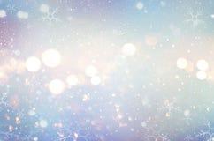 Fondo del invierno del resplandor de la Navidad Fondo Defocused de la nieve foto de archivo libre de regalías
