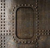 Fondo del metal con los remaches fotos de archivo