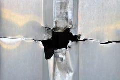 Fondo del metal del agujero Foto de archivo libre de regalías