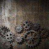 Fondo del metallo con gli ingranaggi arrugginiti Fotografia Stock Libera da Diritti