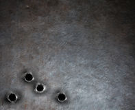 Fondo del metallo dell'armatura con i fori di pallottola Immagini Stock Libere da Diritti