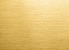 Fondo del metallo spazzolato oro fotografie stock
