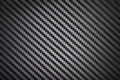 Fondo del modello di struttura della fibra del carbonio tessuto il nero Immagine Stock