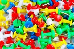 Fondo del modelo de la textura del primer del Pin Contactos coloridos Rojo amarillo, azul, verde fotos de archivo libres de regalías