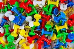 Fondo del modelo de la textura del primer del Pin Contactos coloridos Rojo amarillo, azul, verde fotos de archivo
