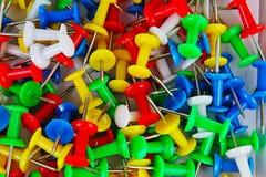 Fondo del modelo de la textura del primer del Pin Contactos coloridos Rojo amarillo, azul, verde imágenes de archivo libres de regalías
