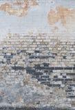 Fondo del muro di mattoni dell'annata con lo stucco Fotografia Stock