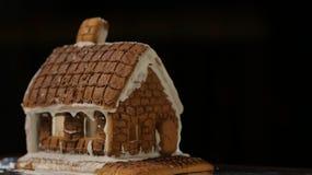 Fondo del negro de la casa de pan de jengibre Foto de archivo
