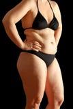 Fondo del negro de las grasas de cuerpo de la mujer Fotos de archivo