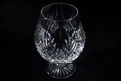 Fondo del negro del vidrio de brandy Foto de archivo libre de regalías