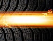 Fondo del neumático y de las llamas Imagenes de archivo