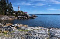 Fondo del noroeste pacífico del paisaje del océano del cielo del faro de Vancouver Fotos de archivo libres de regalías