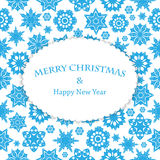 Fondo del nuovo anno e di Natale con i fiocchi di neve ed il posto FO Immagine Stock