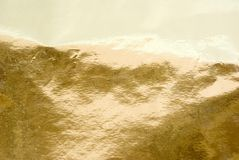 Fondo del oro Imagenes de archivo