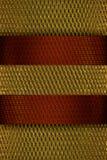 fondo del oro con la cinta roja imagen de archivo libre de regalías