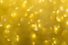 Fondo del oro, Feliz Año Nuevo de la luz de oro abstracta del bokeh Imagen de archivo