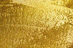 Fondo del oro o sombra de la textura y de las pendientes imagenes de archivo