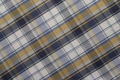 Fondo del paño azul, amarillo y blanco de la tela escocesa imagen de archivo