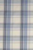 Fondo del paño azul, blanco y negro de la tela escocesa imagenes de archivo
