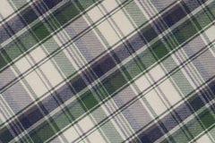 Fondo del paño verde, blanco y negro de la tela escocesa foto de archivo