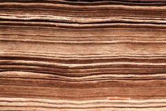 Fondo del papel de libro viejo, macro de las páginas de la espina dorsal Imagen de archivo
