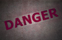 Fondo del piatto d'acciaio con il testo del pericolo Fotografia Stock Libera da Diritti