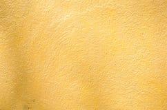 Fondo del primer de la pared del oro Foto de archivo