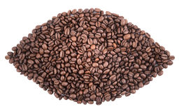 Fondo del primer de los granos de café imagenes de archivo