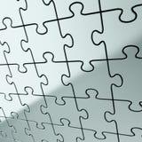 Fondo del puzzle di puzzle fatto dei pezzi brillanti del metallo Fotografie Stock Libere da Diritti