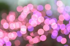 Fondo del rosa & delle luci di Natale vaghe porpora fotografia stock