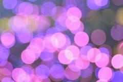 Fondo del rosa & delle luci di Natale vaghe porpora fotografie stock libere da diritti