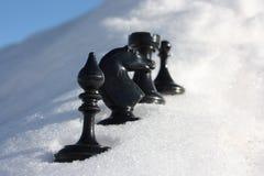 Fondo del `s del Año Nuevo paño de la nieve chessmen Fotos de archivo libres de regalías