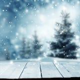 Fondo del saludo de la Feliz Navidad y de la Feliz Año Nuevo con el tabl fotos de archivo libres de regalías