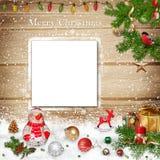 Fondo del saludo de la Navidad con la tarjeta Fotografía de archivo libre de regalías