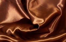 Fondo del satén del color del chocolate Imágenes de archivo libres de regalías