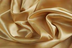 Fondo del satén del oro - horizontal Imagenes de archivo