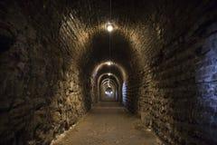 Fondo del túnel de la textura de la piedra y de las paredes de ladrillo Fotografía de archivo