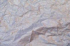 Fondo del tejido arrugado de plata y de oro del crespón imagen de archivo
