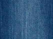 Fondo del tessuto delle blue jeans, nuova struttura normale del panno del denim Fotografia Stock