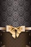 Fondo del vintage con el arco elegante del oro Foto de archivo libre de regalías