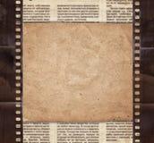 Fondo del vintage con el papel retro, el periódico y el stri viejo de la película Imágenes de archivo libres de regalías